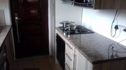 DUBE 2bedroomed house to rent for R2500 pre-paid electricity BATHROOM AND KITCHEN AND LOUNGE